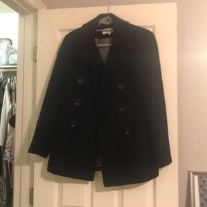 Black peacoat with button closure